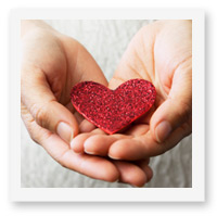 stay inspired with happiness, laughter and love - hands holding a glitter heart