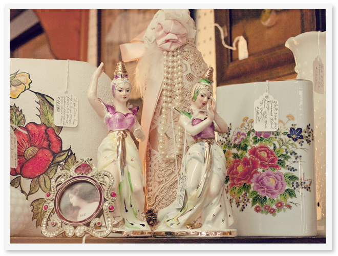 photo of antique porcelain figurines and vases