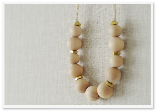 Wooden bead necklace by Sally J. Shim