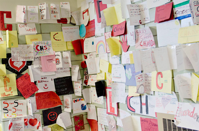 A wall covered in greeting cards created by children at a school in Chardon, Ohio.