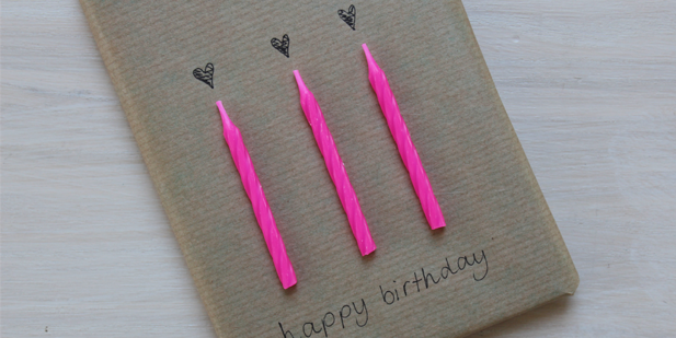 Birthday Candles on brown gift wrapping paper by Nooha