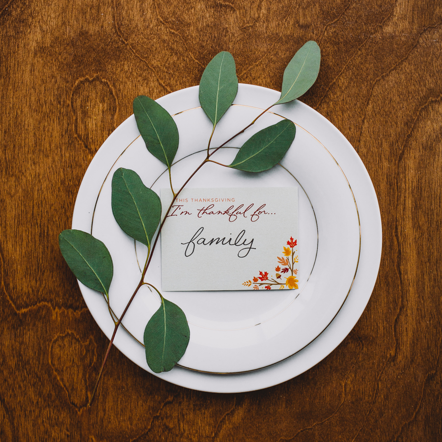 I'm thankful for Thanksgiving notecard on a dinner plate with small branch