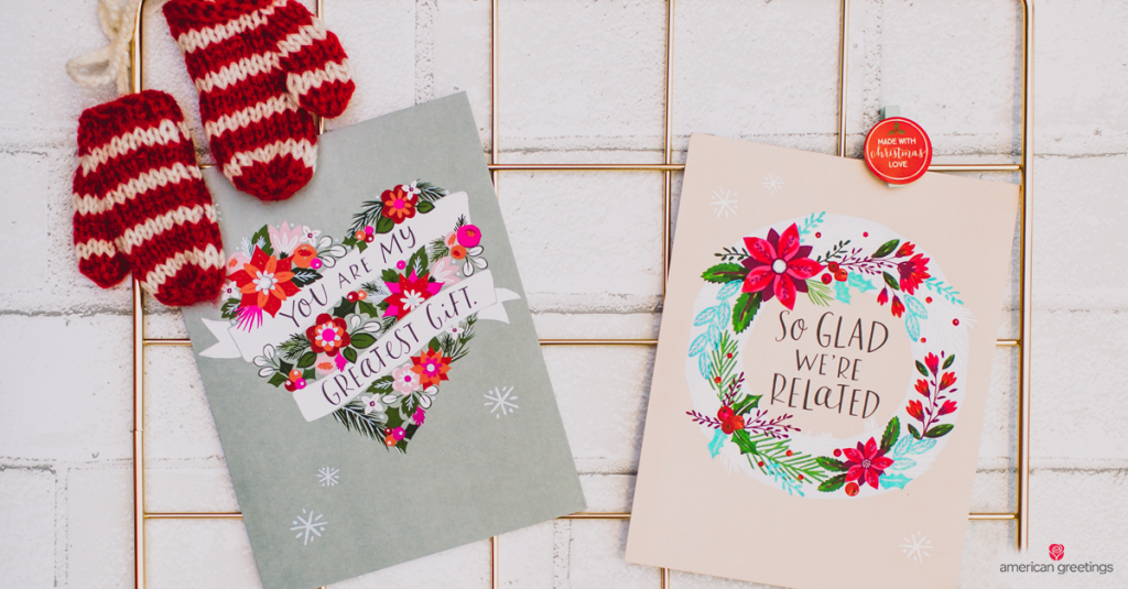 two Christmas cards placed together with tiny mittens