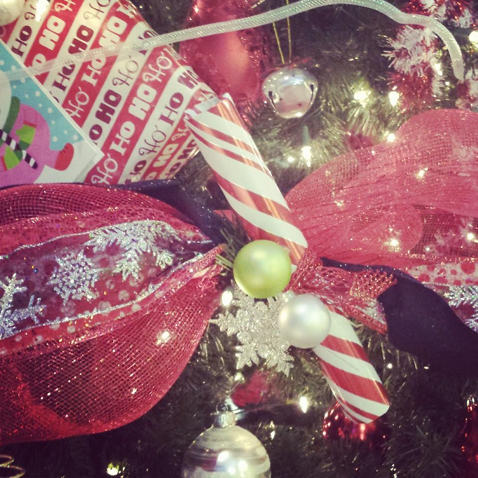 Make your tree pop by tying short scrolls of wrapping paper with bows and attaching them to your tree--an inexpensive way to make a big splash!